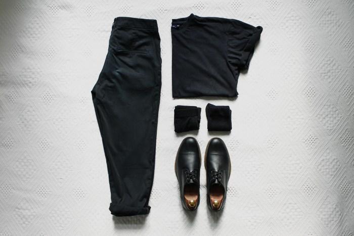 Black chinos, black derbys, a black t-shirt, black socks and black boxers.