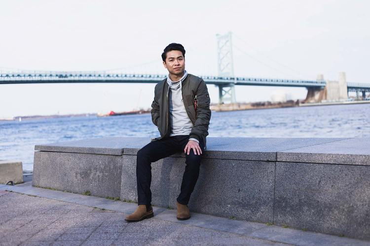 Alpha Industries MA-1 Skymaster Flight Bomber Jacket In Front of A Bridge