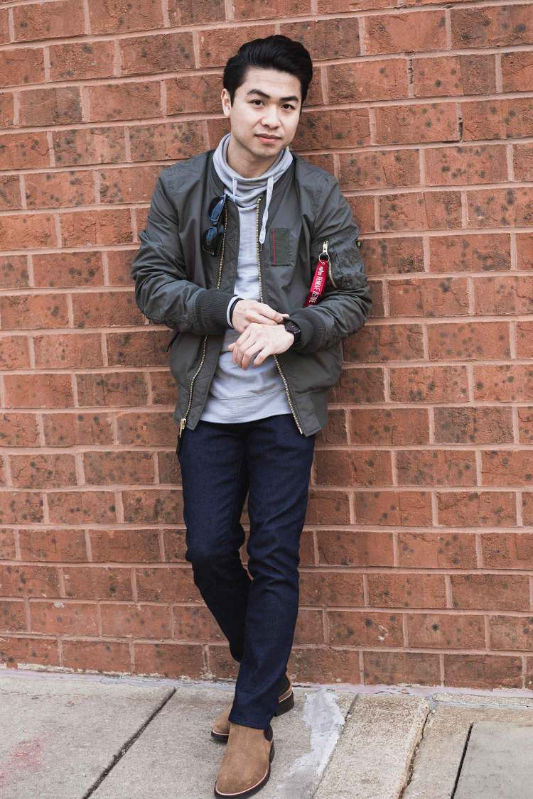 Alpha Industries MA-1 Skymaster Flight Bomber Jacket In Front of A Wall