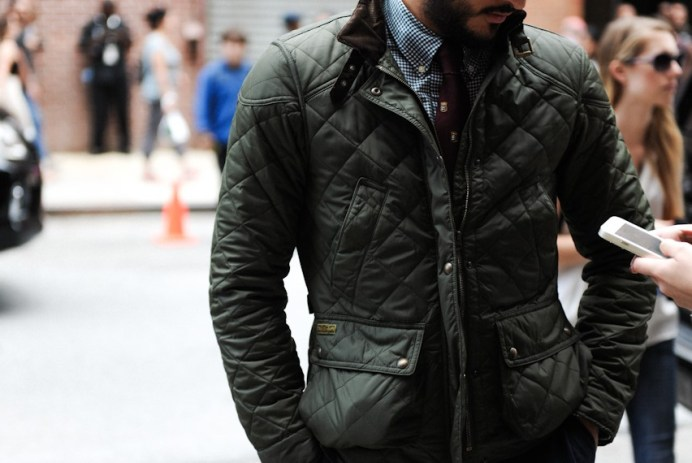 Man wearing a quilted jacket stylishly