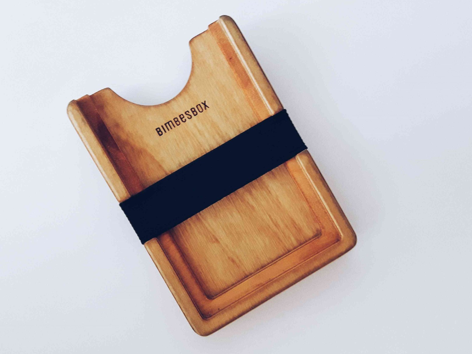 The wooden cardholder