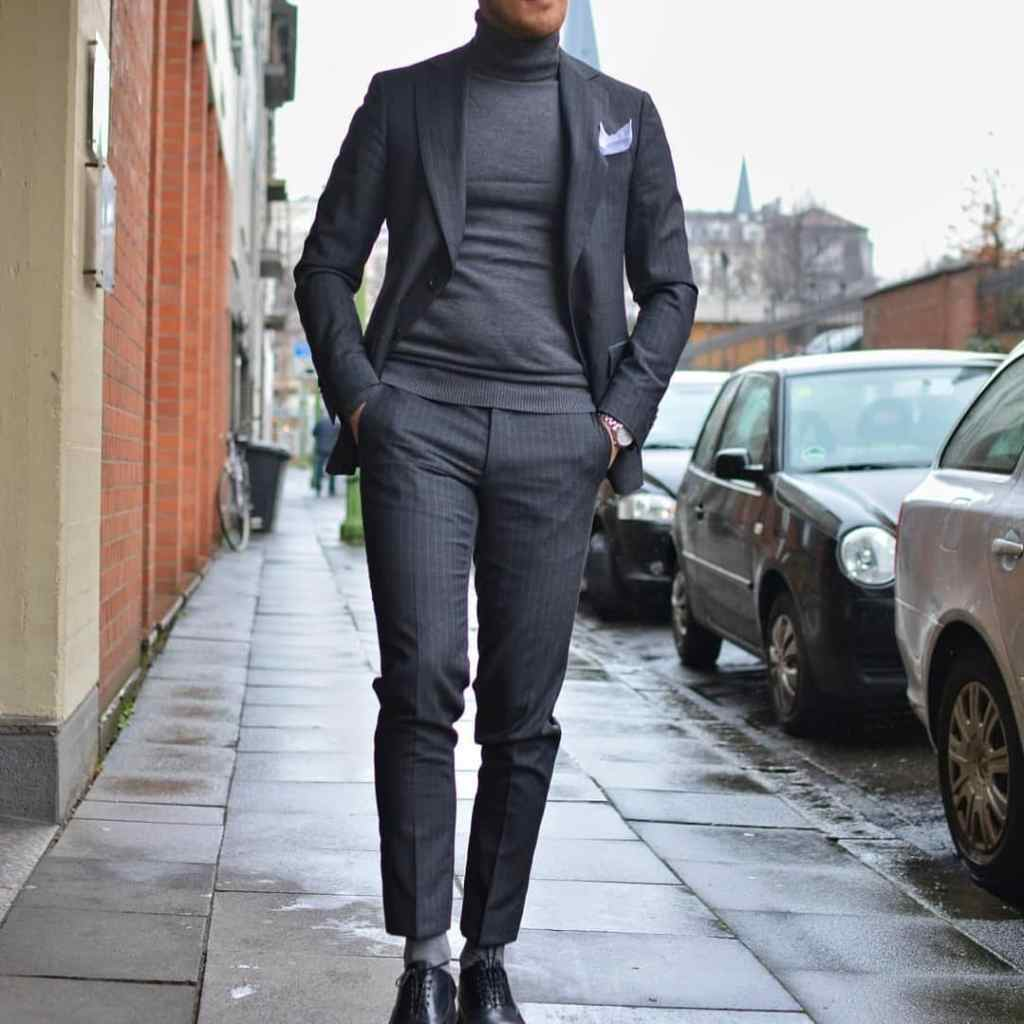 Charcoal power suit with a turtleneck shirt.