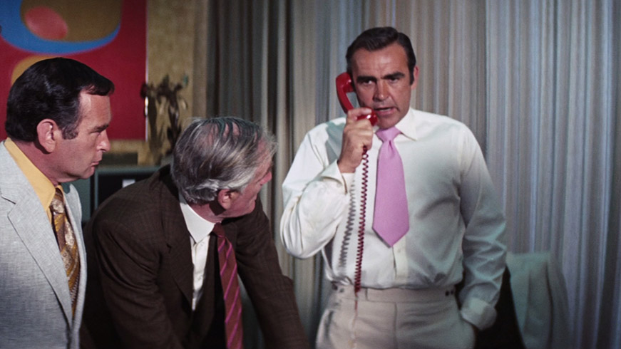 Sean Connery wearing a hideous pink tie.