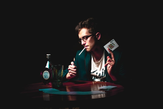 Gentleman having a smoke and drink on a poker game