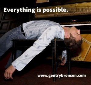 Gentry Bronson laying across a piano bench