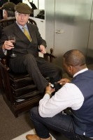 Guest Receiving Shoe Shine at Left Shoe Company NYC Pop-Up Opening