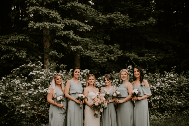 Bride and bridesmaids in alternative mix and match dresses.