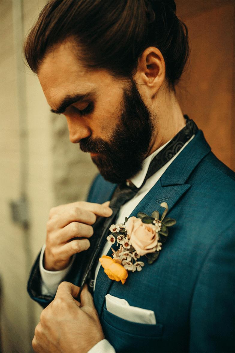 groom in blue suit