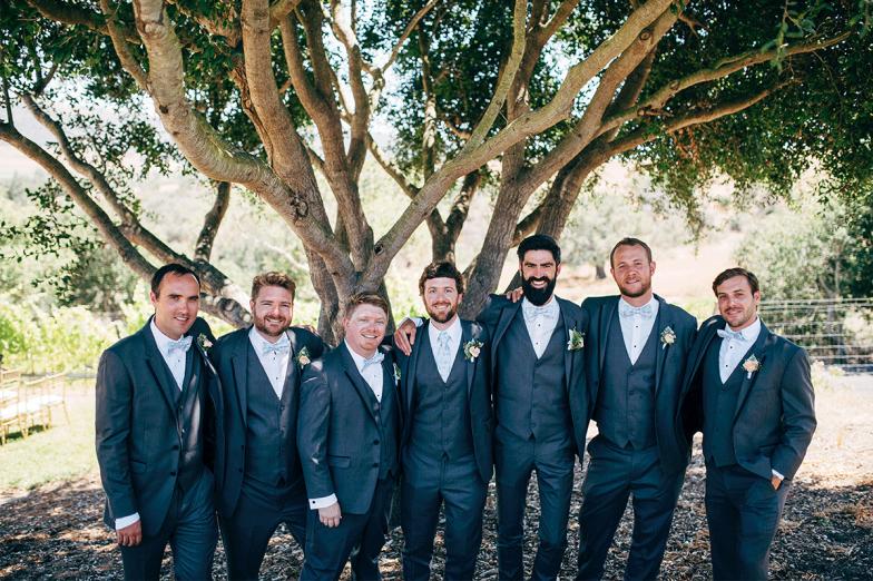 groom and groomsmen in gray tuxedo