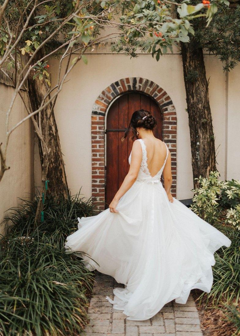 Birde twirling in wedding dress