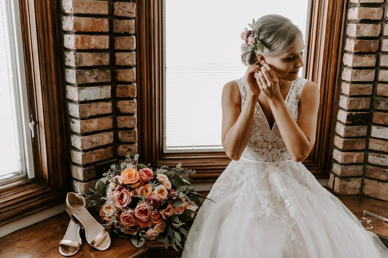 Bride getting ready and putting on earrings