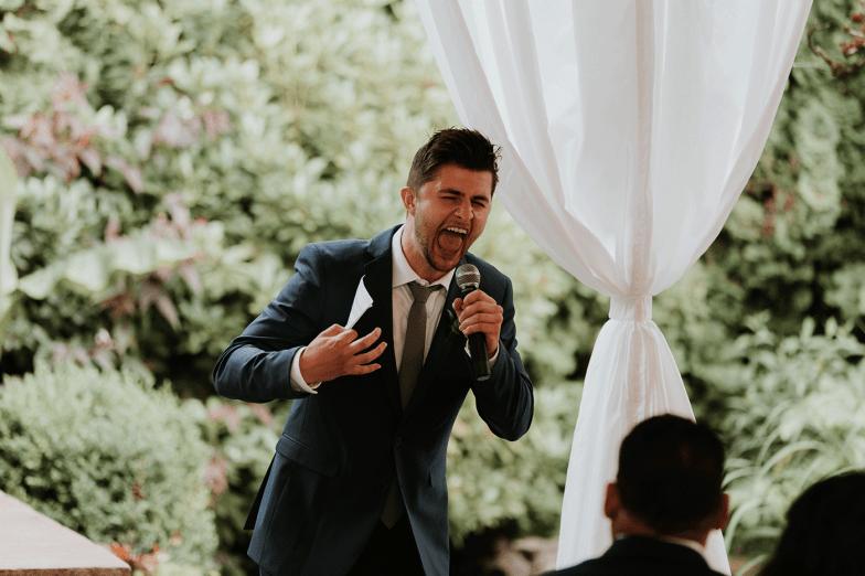 best man laughing giving speech