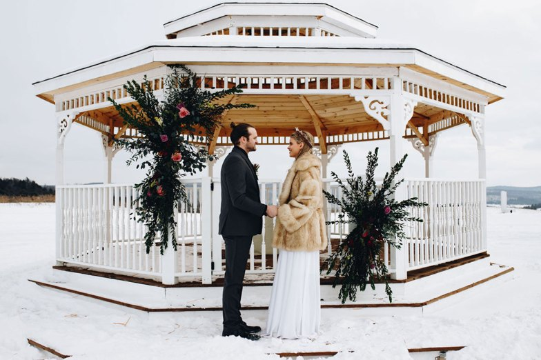 Bride and groom in gray suit in snow