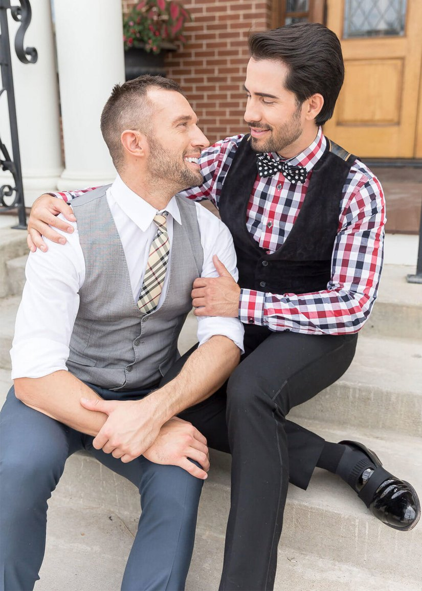 two grooms in contrasting suits