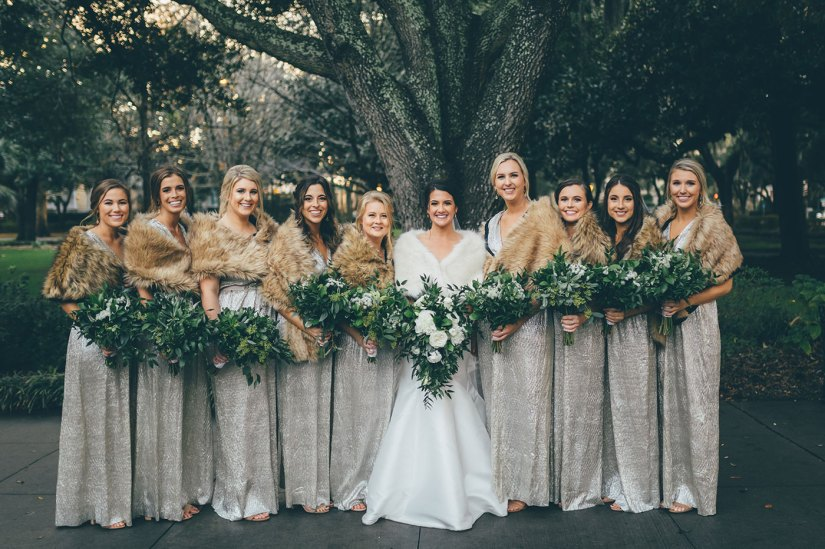 bride with bridesmaids in silver dresses and fur shawls