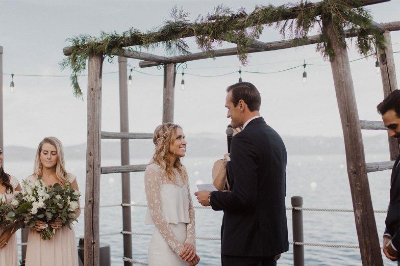 bride and groom in navy suit getting married
