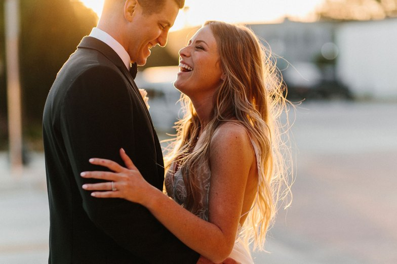 picture of a bride and groom laughing during their wedding