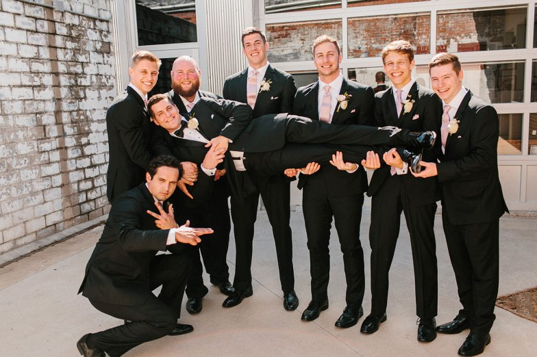 picture of a groom and his groomsmen posing during a wedding