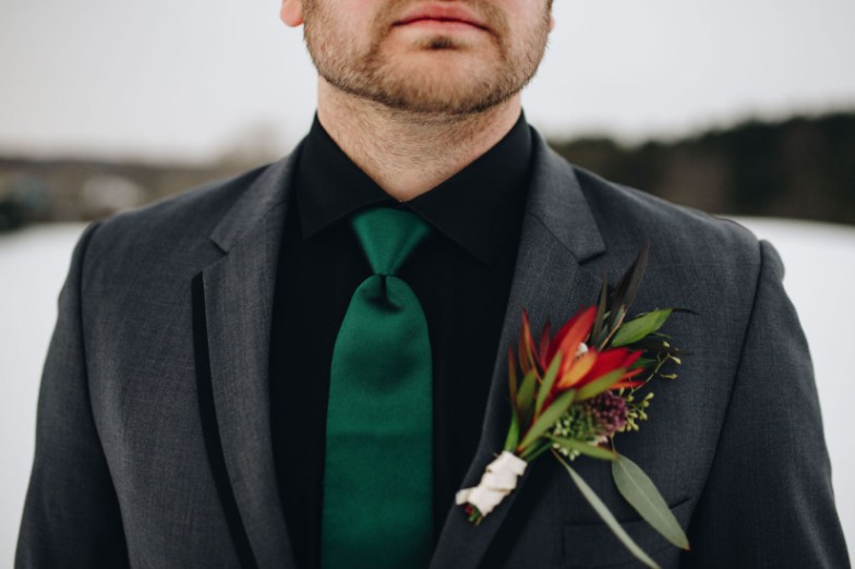 Groom wearing Generation Tux Charcoal Gray Tux with Emerald Tie