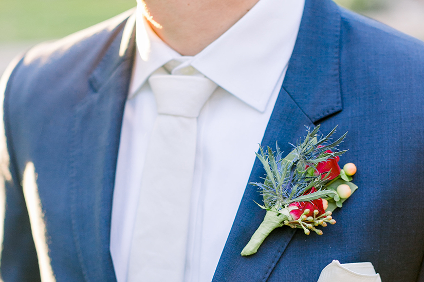 groom in generation tux suite and boutonniere