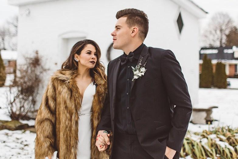 bride and groom posing in winter wedding