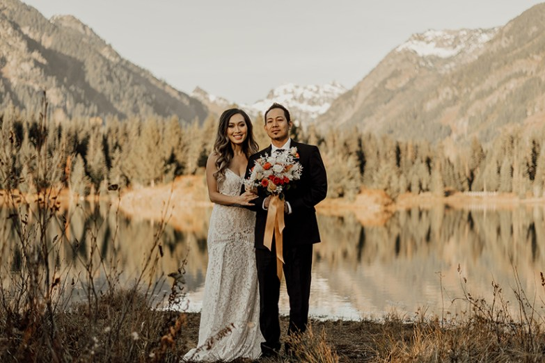 bride and groom in winter mountain wedding