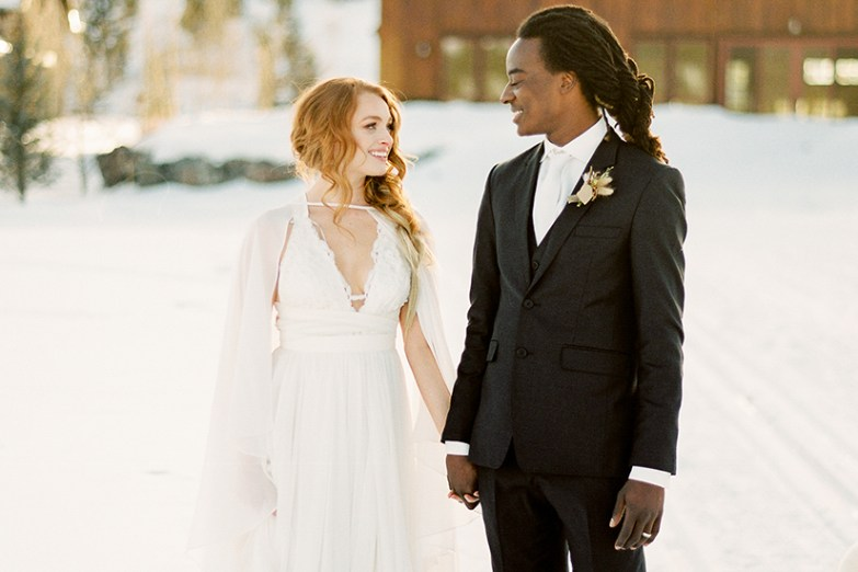bride and groom in snow winter wedding