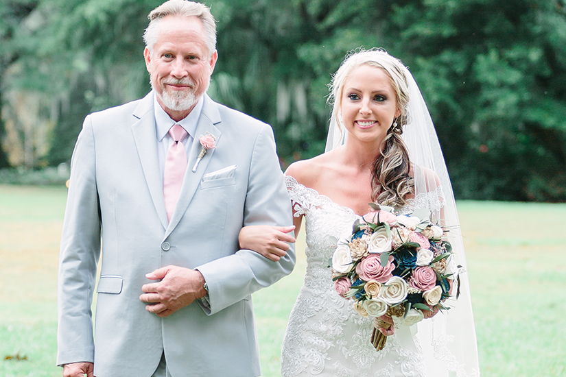 Father in generation tux with bride