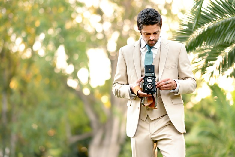 Generation tux model in british tan suit and camera
