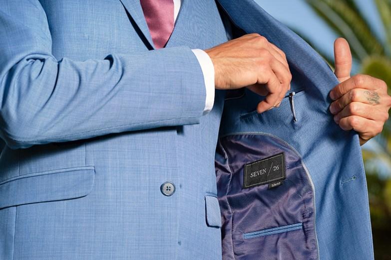 Closeup of Generation Tux postman blue suit