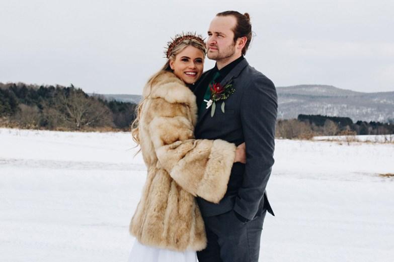Groom in Iron Gray Suit with bride in fur coat