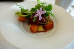 Cornish lamb loin, braised neck, salt baked carrots, yuzu, charred lettuce, mustard