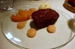 Spiced parkin with poached quince and honey and stem ginger ice cream