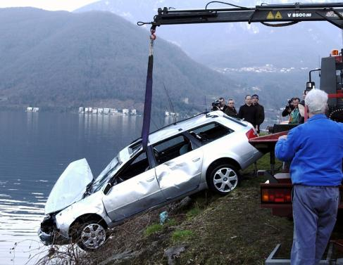 The car of Helios Jermini, president of Swiss soccer club FC Lugano, is pulled out of the lake of Lugano, Thursday, March 7, 2002, in Brusino, Southern Switzerland. Jermini was found dead inside his car. The 63-years-old soccer club president had been missing since Tuesday, March 5. The cause of death ist not known at the moment.  (KEYSTONE/Karl Mathis) === ELECTRONIC  IMAGE ===