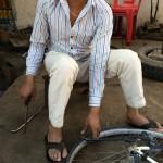 A bike mehanic in cream trousers!