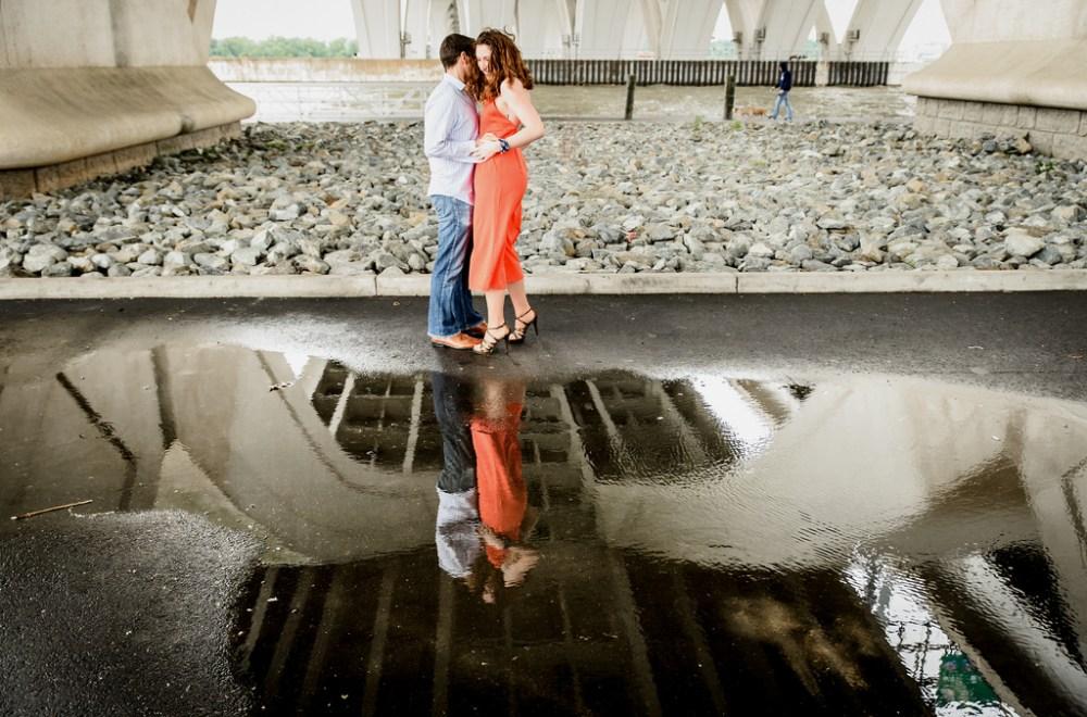 Engagement shot under a bridge.