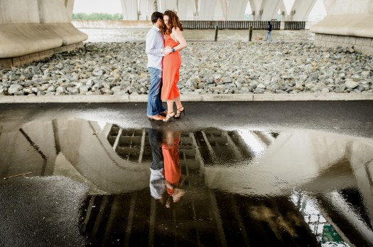 Engagement shot under a bridge.