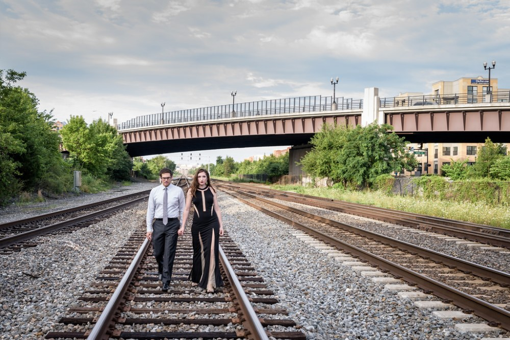 Engagement shot on railroad tracks.
