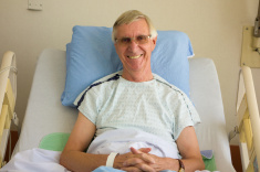 mature-man-smiles-from-his-hospital-bed