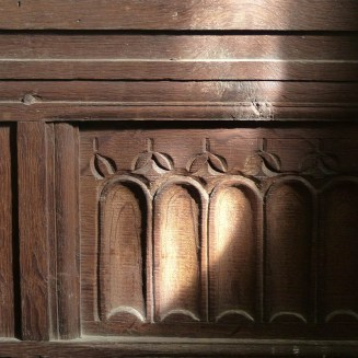 A catchlight on the carving