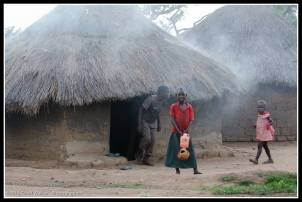 Look at the doll and they are cooking in the hut behind.