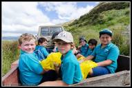 Pirinoa School kids geetting a ride.
