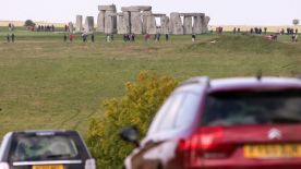 AMESBURY, ENGLAND - OCTOBER 13: Traffic passes along the busy A303 that runs besides the ancient neolithic monument of Stonehenge on October 13, 2015 in Wiltshire, England. The UK Government has announced today that it is committed to building a tunnel under the UNESCO listed ancient monument as part of a £2 billion spend on road projects in the South West of England between now and 2021 by Highways England. (Photo by Matt Cardy/Getty Images)