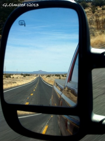Side mirror view of Red Butte AZ