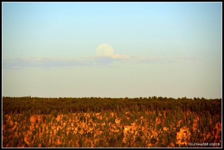 Full moon rise over Walhalla Plateau from Bright Angel Point trailhead North Rim Grand Canyon National Park Arizona