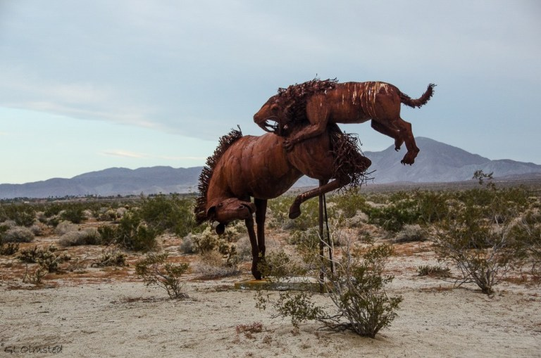 Gracile Sabertooth Cat attacking Extinct Horse metal sculpture by Ricardo Breceda Galleta Meadows Borrego Springs California