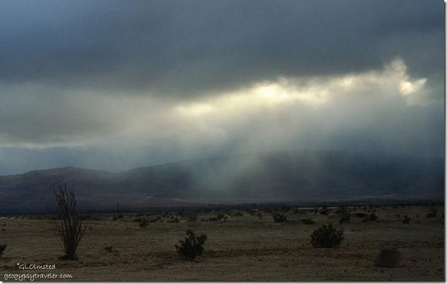 Last light thru storm clouds Vallecito Mountains Anza-Borrego Desert State Park California