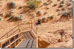 Bill and Sasha at bottom of stairs Atlatl Rock Valley of Fire State Park Nevada