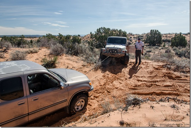 Bill's truck being winched by Jeep Sand dune ATV trail to Peekaboo Canyon Utah