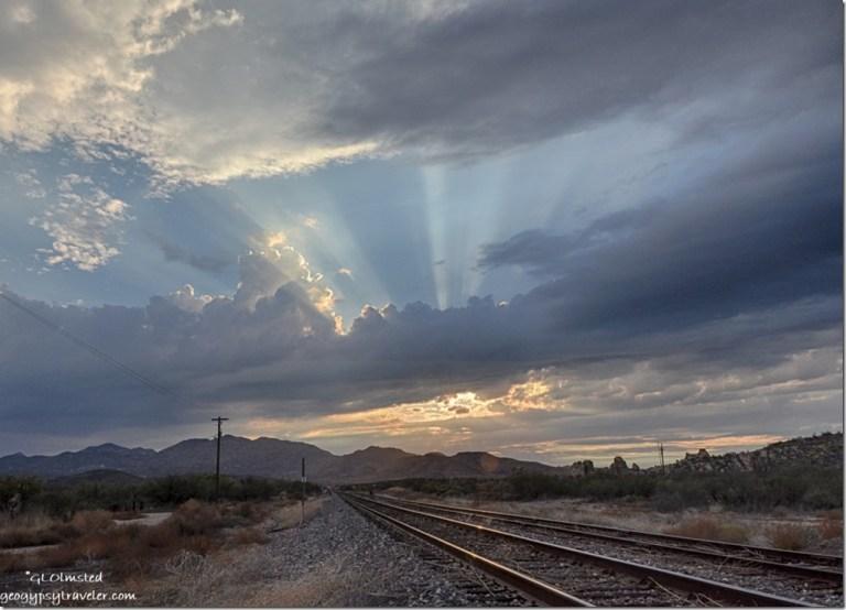 crepuscular rays RR tracks sunset Kirkland Arizona
